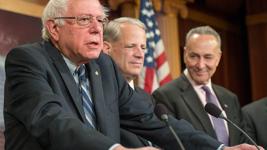 Vermont Sen. Bernie Sanders (left) sits alongside Steve Israel, a former Democrat member of Congress from Long Island, N.Y., and New York Sen. Chuck Schumer (right) on Capitol Hill in 2015. Credit: Wikimedia Commons.