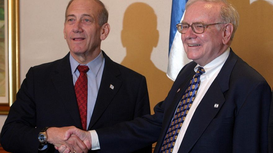 Israeli Prime Minister Ehud Olmert (left) shakes hands with investor Warren Buffett during a meeting at the Prime Minister's Office in Jerusalem on Sept. 18, 2006. Photo by Orel Cohen/Flash90