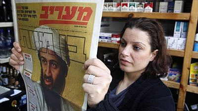 Israelis read about the death of Al-Qaeda leader Osama bin Laden in the news on May 3, 2011. Photo by Miriam Alster/Flash90