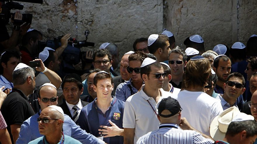 Lionel Messi (center) seen surrounded by press and security, as he and the FC Barcelona team arrive at the Western Wall in Jerusalem on Aug. 4, 2013. Photo by Miriam Alster/Flash90.