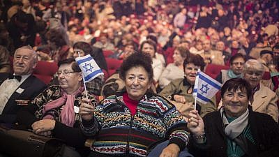 Russian immigrants (new olim) attend an event marking the 25th anniversary of the great Russian aliyah to Israel from the former Soviet Union at the Jerusalem Convention Center on Dec. 24, 2015. Photo by Hadas Parush/Flash90