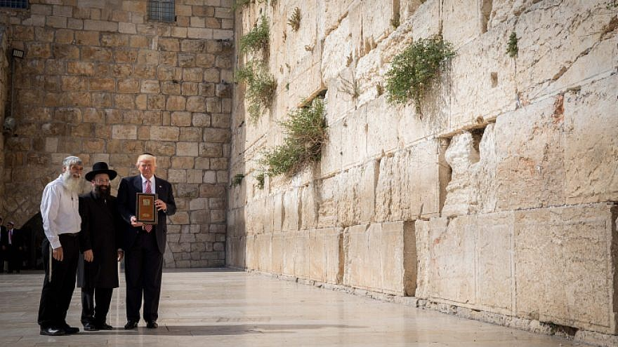 U.S. President Donald Trump at the Western Wall, Judaism's holiest prayer site, in the Old City of Jerusalem on May 22, 2017. To his left is the rabbi of the wall, Shmuel Rabinovitch. Photo by Nati Shohat/Flash90