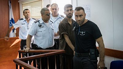 Omar Al-abed is brought to the courtroom for his trial at the Israel's Ofer military court near the West Bank city of Ramallah on Aug. 17, 2017. Alabed was detained after committing a deadly stabbing terror attack, killing Yosef Salomon (70), his daughter Haya (46) and son Elad (35) at their home in the Jewish settlement of Halamish. Photo by Yonatan Sindel/Flash90