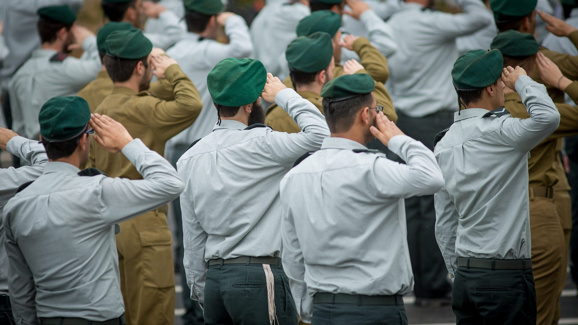 "Israeli soldiers of the IDF Intelligence Unit. The ""Unit 9900"" or Ro'im Rachok, is a unit of the IDF's Military Intelligence Directorate that specifically recruits teenagers on the autism spectum to analyze aerial and satellite photographs. Credit: Miriam Alster/Flash90"