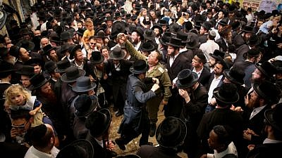 Jewish men celebrate the Jewish holiday of Lag B'Omer in the northern Israel town of Meron on May 3, 2018. Lag B'Omer commemorates the death of Rabbi Shimon bar Yochai, one of the most important sages in Jewish history, more than 1,800 years ago. Photo by David Cohen/Flash90.