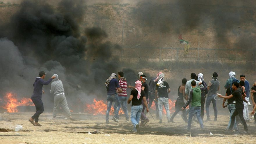 """Palestinians stage another weekly Friday demonstration as part of the """"March of Return"""" near the Gaza-Israel border on May 4, 2018. Photo by Abed Rahim Khatib/Flash90."""