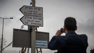 Municipal workers hang a road sign directing to the new U.S. embassy near the U.S. consulate in Jerusalem on May 7, 2018. Photo by Yonatan Sindel/Flash90