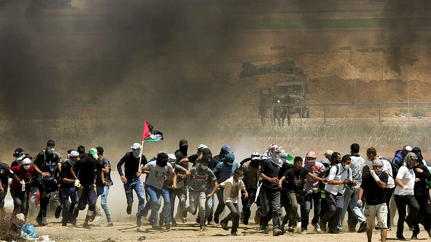Palestinian protesters during clashes with Israeli forces along the border with Gaza on May 11, 2018. Credit: Abed Rahim Khatib/Flash90.