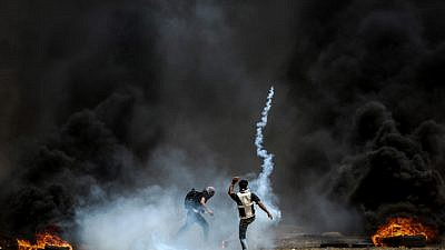 Palestinian protesters during clashes with Israeli forces along the border with Gaza on May 11, 2018. Photo by Abed Rahim Khatib/Flash90