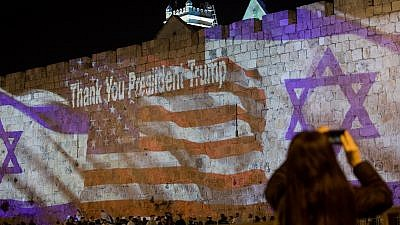 Israeli and the American flags are screened on the walls of Jerusalem's Old City on May 13, 2018, ahead of the opening of the U.S. embassy in Jerusalem. Credit: Yontan Sindel/Flash90.