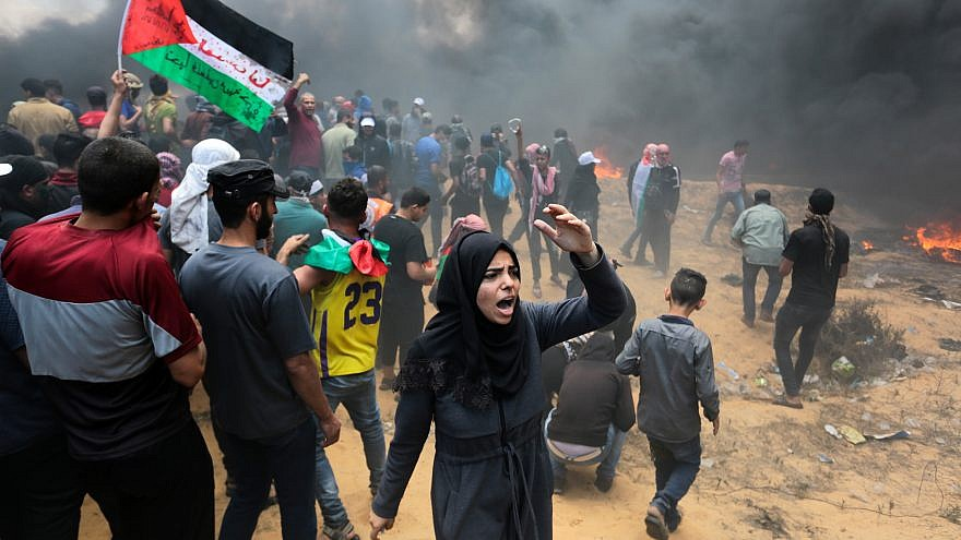Palestinian protesters clash with Israeli forces near the Gaza-Israel border on May 14, 2018. Credit: Abed Rahim Khatib/Flash90.