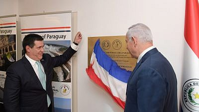 Israeli Prime Minister Benjamin Netanyahu and President of Paraguay Horacio Cartes (left) at the official opening ceremony of the Paraguay embassy in Jerusalem on May 21, 2018. Photo by Amos Ben Gershom/GPO