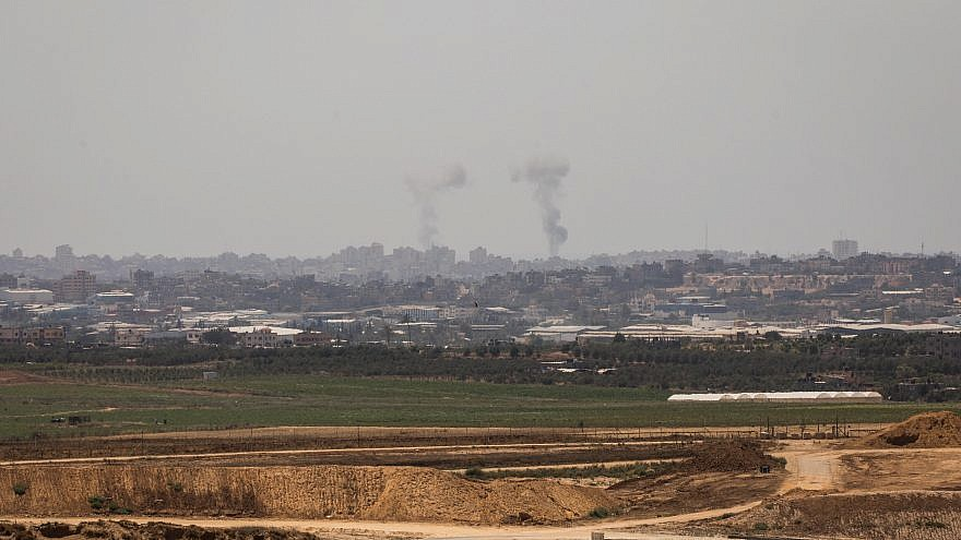 Smoke rises following an Israeli attack on the Gaza Strip as it seen from the Israeli side of the border on May 29, 2018. Photo by Yonatan Sindel/Flash90.