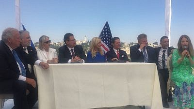 Faith initiative leaders gathered on the rooftop of the Aish HaTorah Jewish learning center overlooking the Western Wall and the Temple Mount. Credit: Alex Traiman.