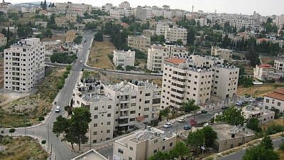 Apartment buildings in a residential neighborhood in Ramallah. (Wikimedia Commons)