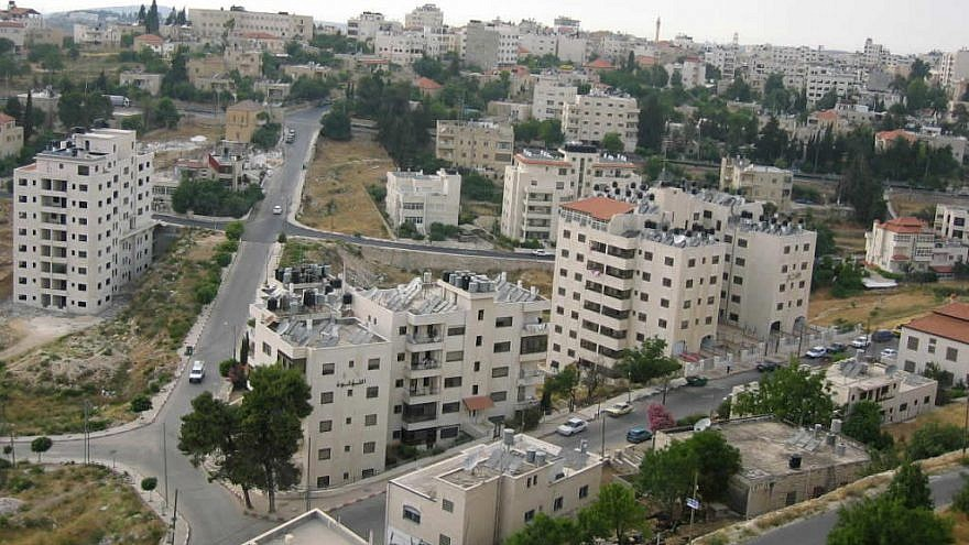 Apartment buildings in a residential neighborhood in Ramallah. Credit: Wikimedia Commons.