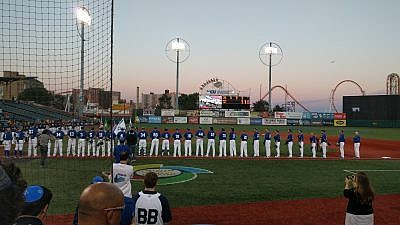 "Team Israel wearing their kippot during the Israeli national anthem ""Hatikvah"" before the ball game against Great Britain on Sept. 22, 2016. Credit: Wikimedia Commons."