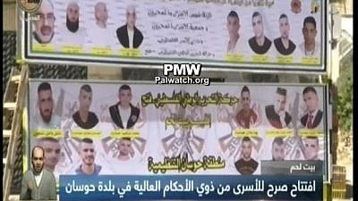 PA and Fatah honor terrorists with huge billboard, including one serving 10 life sentences for recruiting suicide bomber who murdered 8 (Official PA TV News, April 24, 2018-PMW)