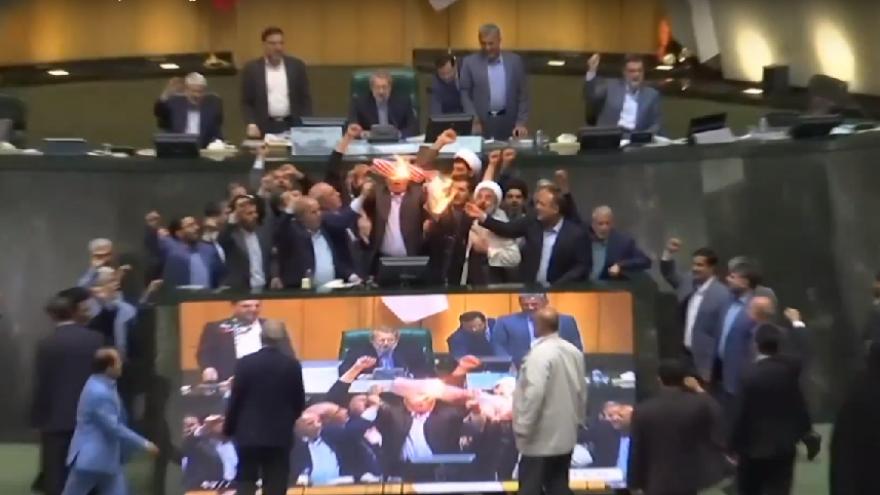 "Iranian parliamentarians burn American flag and chant ""Death to America!"" in Tehran. Source: Screenshot."