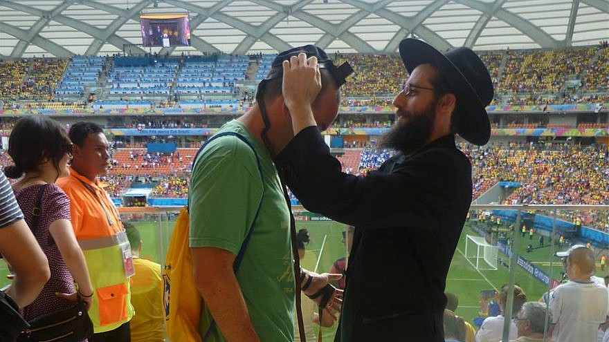Among the thousands of Jewish fans traveling to the World Cup will be many Westerners and Israelis who have never been to Russia. Chabad centers around the country are preparing to welcome them and encourage them to explore all aspects of Jewish life, as Chabad representatives did four years ago at the World Cup games in Brazil, above. (Chabad.org)