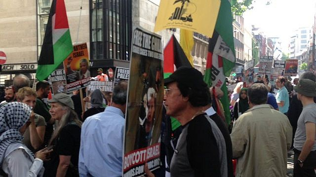 """A Hezbollah flag during """"Al-Quds Day"""" demonstrations on the streets of London. Credit: Zionist Federation via Twitter."""