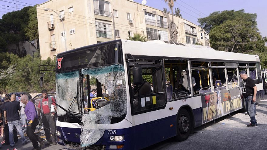Israeli police and rescue personnel at the scene of a bombing on a Tel Aviv passenger bus on Nov. 21 2012 . Photo by Tomer Neuberg/ Flash90.