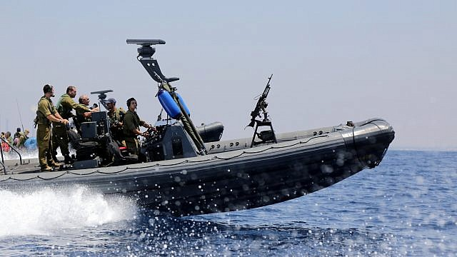 """Israeli Navy soldiers seen on IDF ships, off the coast of Gaza, during Operation """"Protective Edge"""" on July 28, 2014. Credit: Edi Israel/FLASH90"""