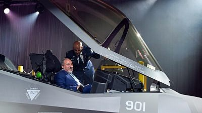 Israeli Defense Minister Avigdor Lieberman sits inside the new F-35 stealth aircraft during a ceremony at the manufacturing factory the Lockheed Martin aerospace company in Fort Worth near Dallas on June 23, 2016. Photo by Ariel Hermoni/Ministry of Defense.