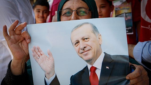 Palestinians holds pictures of the Turkish president Recep Tayyip Erdoğan as they wear shirts with Turkish flags in the West Bank city of Hebron on July 20, 2016. Photo by Wisam Hashlamoun/Flash90.