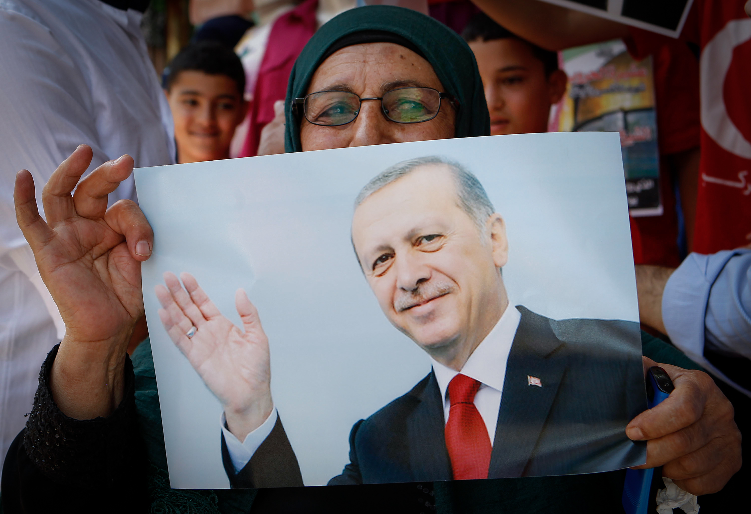 Palestinians holds pictures of the Turkish president Recep Tayyip Erdoğan