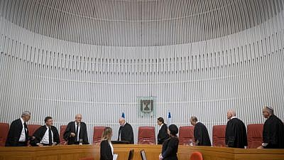 Israeli Supreme Court justices and president Esther Hayut arrive to the courtroom of the Supreme Court in Jerusalem. Photo by Yonatan Sindel/Flash90.