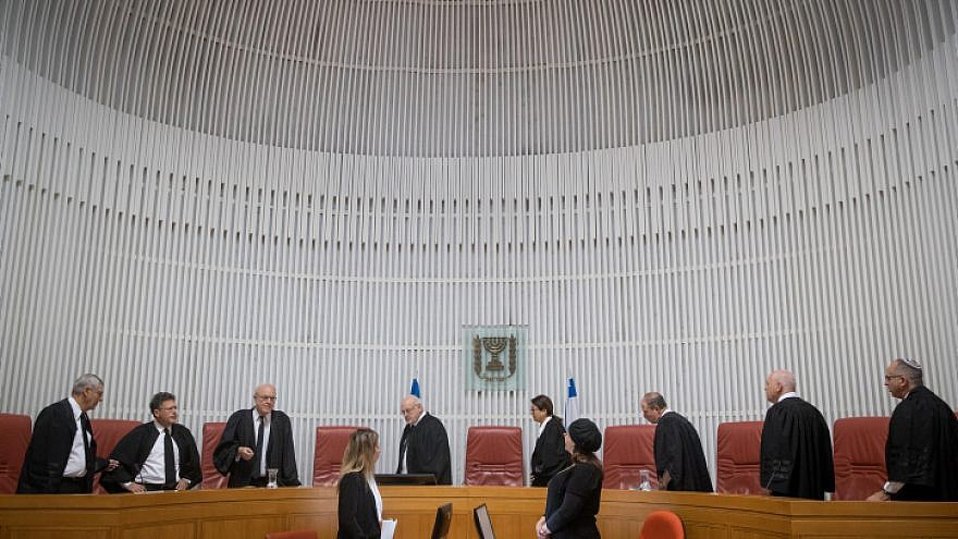 Israeli Supreme Court justices, in addition to Supreme Court president Esther Hayut, arrive in the courtroom in Jerusalem. Photo by Yonatan Sindel/Flash90.