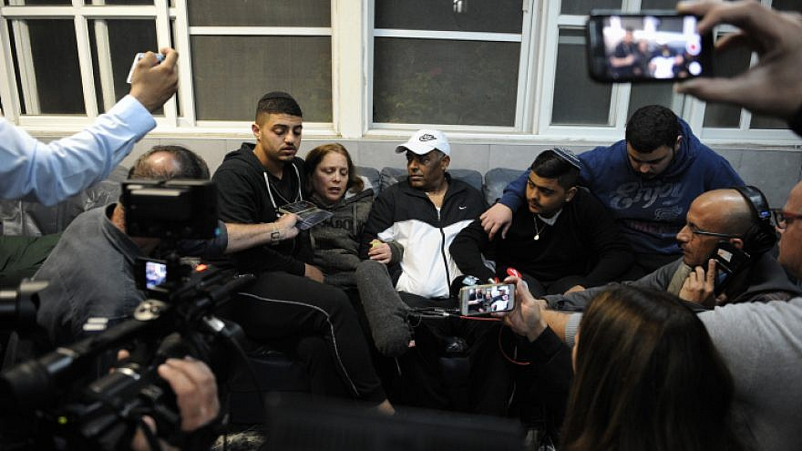 Family of Israeli soldier Netanel Kahalani mourn his death at their home in Elyakim, on March 17, 2018. Kahalni was murdered along with fellow soldier Ziv Daus, and two tohers injured, in a car-ramming terror attack near Mevo Dothan, in the West Bank. Photo by Meir Vaknin/Flash90.