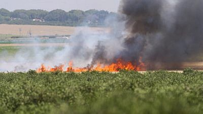 Smoke rises from Israeli agricultural fields near the Israeli border with the Gaza Strip, after being set on fire by a flaming kite flown over by Palestinians as they protest by the border fence on May 14, 2018. Photo by Flash90.