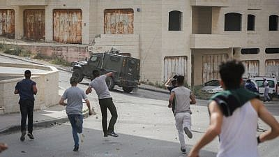 Palestinians clash with Israeli security forces during a raid of the Israeli army in the West Bank village of Amari near Ramallah on May 28, 2018. Photo by Flash90