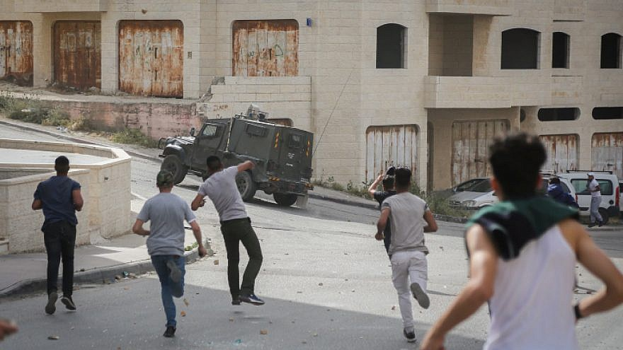 Palestinians clash with Israeli security forces during a raid of the Israeli army in the West Bank village of al-Am'ari near Ramallah on May 28, 2018. Photo by Flash90.