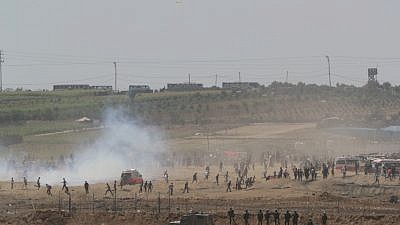 Palestinians burn tires as they protest by the fence on the border between Gaza and Israel, as seen from the Israeli side of the border, June 8, 2018. Photo by Yonatan Sindel/Flash90.