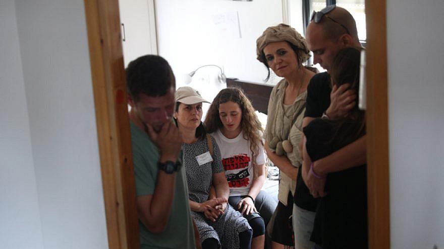 Israeli authorities evacuate people from a home in Netiv Ha'avot on June 12, 2018. Photo by Yonatan Sindel/Flash90.