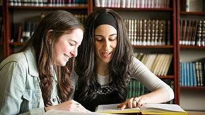 Young women taking part in program sponsored by the Orthodox Union that seeks to pair a a female member of a synagogue's staff with a teen to learn. Credit Orthodox Union.