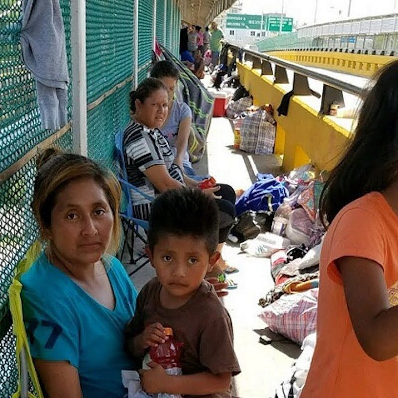 Children with their parents at the U.S.-Mexico border. YouTube.