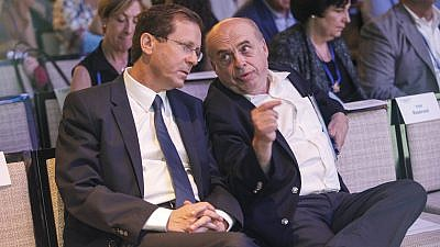 Isaac Herzog, left, speaks with outgoing Jewish Agency chairman Natan Sharansky following Herzog's election as the next chairman at the Jewish Agency Board of Governors' meetings in Jerusalem on June 24, 2018. Photo credit: Nir Kafri/The Jewish Agency for Israel.