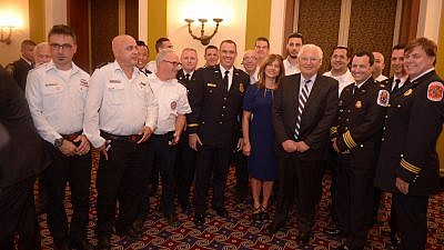U.S. and Israeli first responders gather around U.S. Ambassador David Friedman at an ASTI dinner and awards ceremony held in their honor. Credit: Binyamin Ben Kahlon