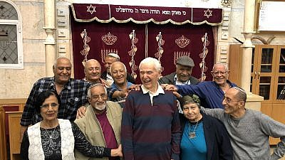 Capt. Elgen Long is embraced by Yemenite Jews during a visit to Israel last fall. Credit: Shahar Azani.
