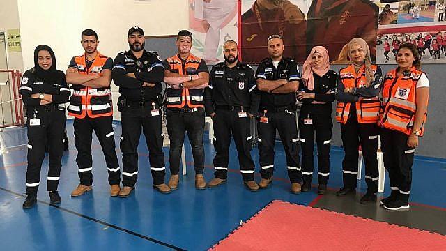 Muslim volunteers of United Hatzalah and the local ambulance team of Kfar Kara pose together after a training session. Sanaa Mahameed is third from right. Credit: United Hatzalah.