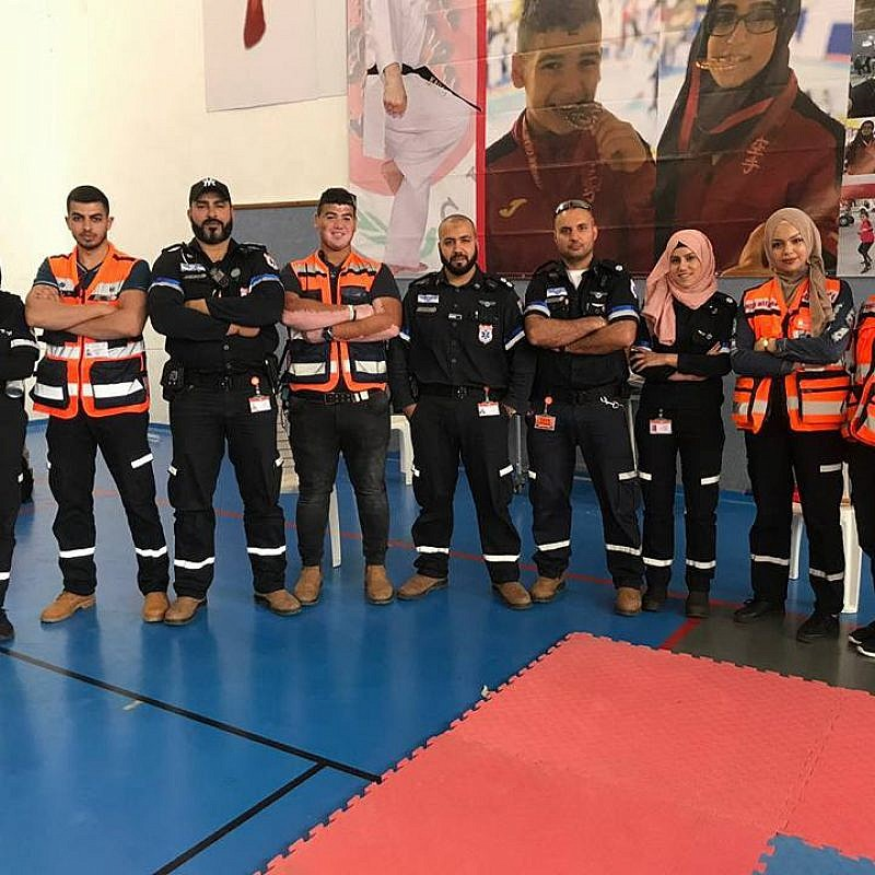 Muslim volunteers of United Hatzalah and the local ambulance team of Kfar Kara pose together after a training session. Sanaa Mahameed is third from right. Credit: United Hatzalah.