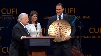 "U.S. Ambassador to the United Nations Nikki Haley was presented with the ""Defender of Israel"" award, eliciting loud cheers from the crowd at the 13th annual Christians United for Israel summit, held from July 23-24, 2018. Screenshot: YouTube."