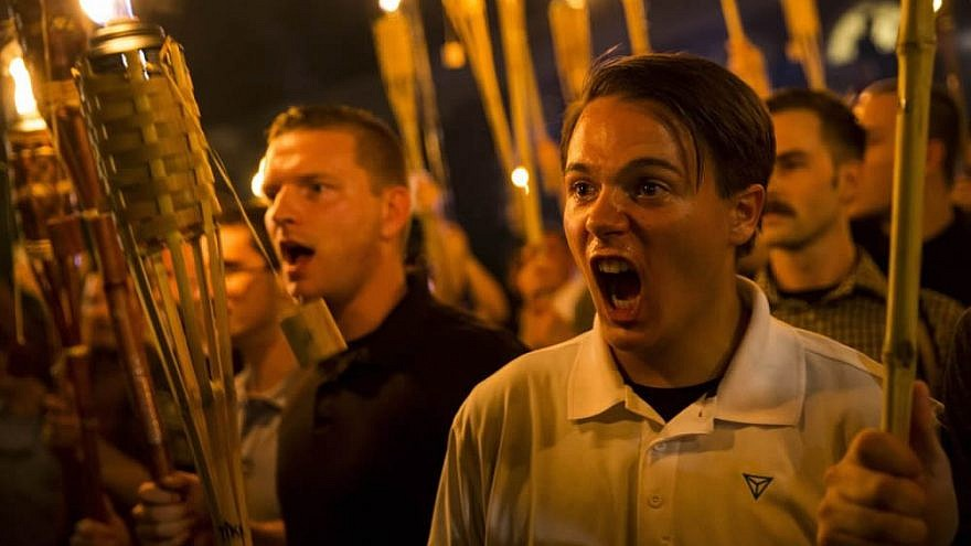 Torch-carrying protesters in Charlottesville march chanting anti-Semitic and anti-minority slogans on on Aug. 11, 2017. Credit: Twitter.