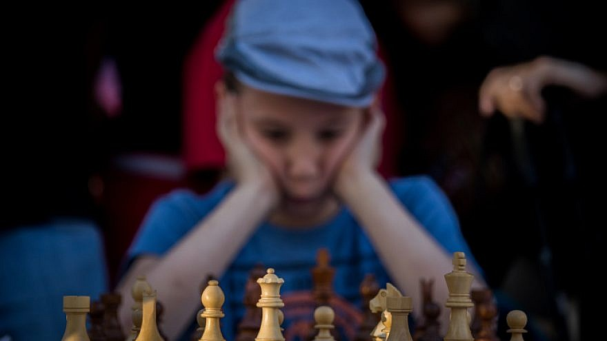 A young Israeli chess player takes part in a special chess tournament in Jerusalem marking Israel's 70th anniversary, April 30, 2018. Photo by Yonatan Sindel/Flash90.