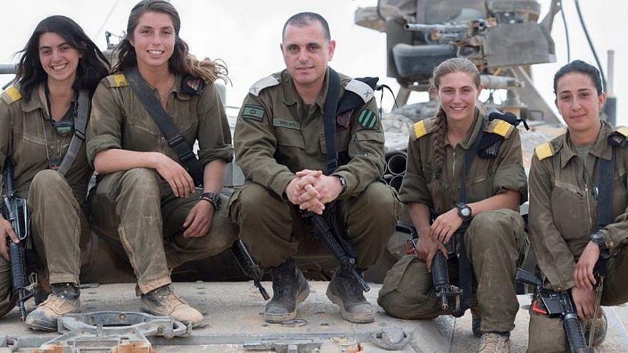 The first four female tank commanders in the Israel Defense Forces pose with Brig. Gen. Guy Hasson, head of the Armored Corps. Credit: IDF Spokesperson Unit.
