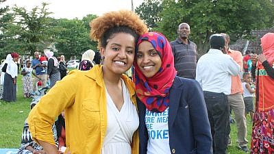 Democratic Party candidate for Congress Ilhan Omar (right), a Somali American who represents Minnesota, appears alongside a supporter at a July 4 barbecue. Credit: Ilhan Omar via Twitter.